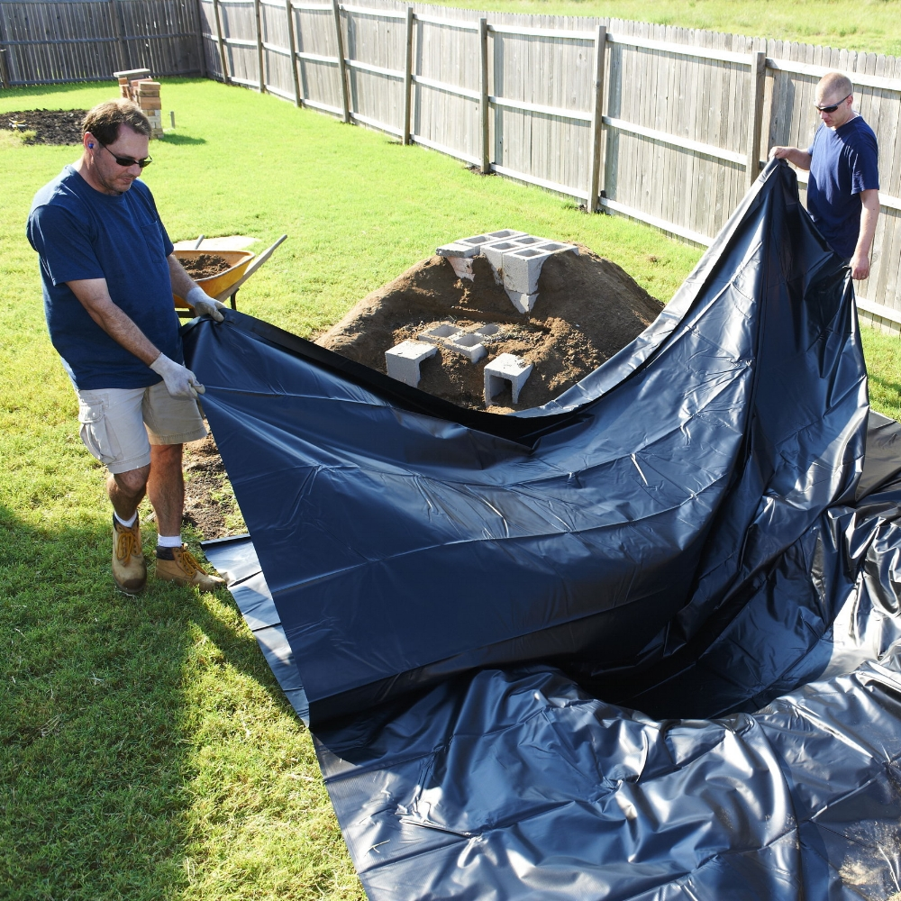 Step 5 - Unfold two 13 x 20 ft. PVC Pond Liners and cover the pond and waterfall, using Seaming Tape to merge them together.  Place the smooth side of the liner down. The liner should extend at least 10 in. past the elevated edge.