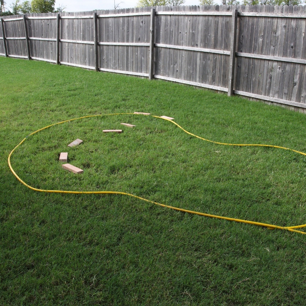 Step 1 - Ensure the area is level. Map out the shape and size of the overall pond using a rope or string.