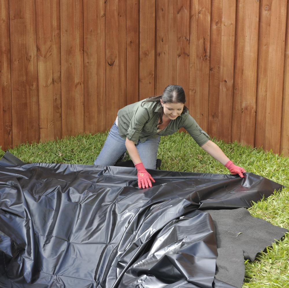 Step 4 - Lay the liner. There should be at least a 10-12 in. overhang. If roots and/or debris are present, line the bottom with old carpet or sand to protect the liner from punctures.