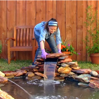 Step 6 - To complete the look, stack the rocks and stones around and on the Spillway as a natural disguise. Enjoy!
