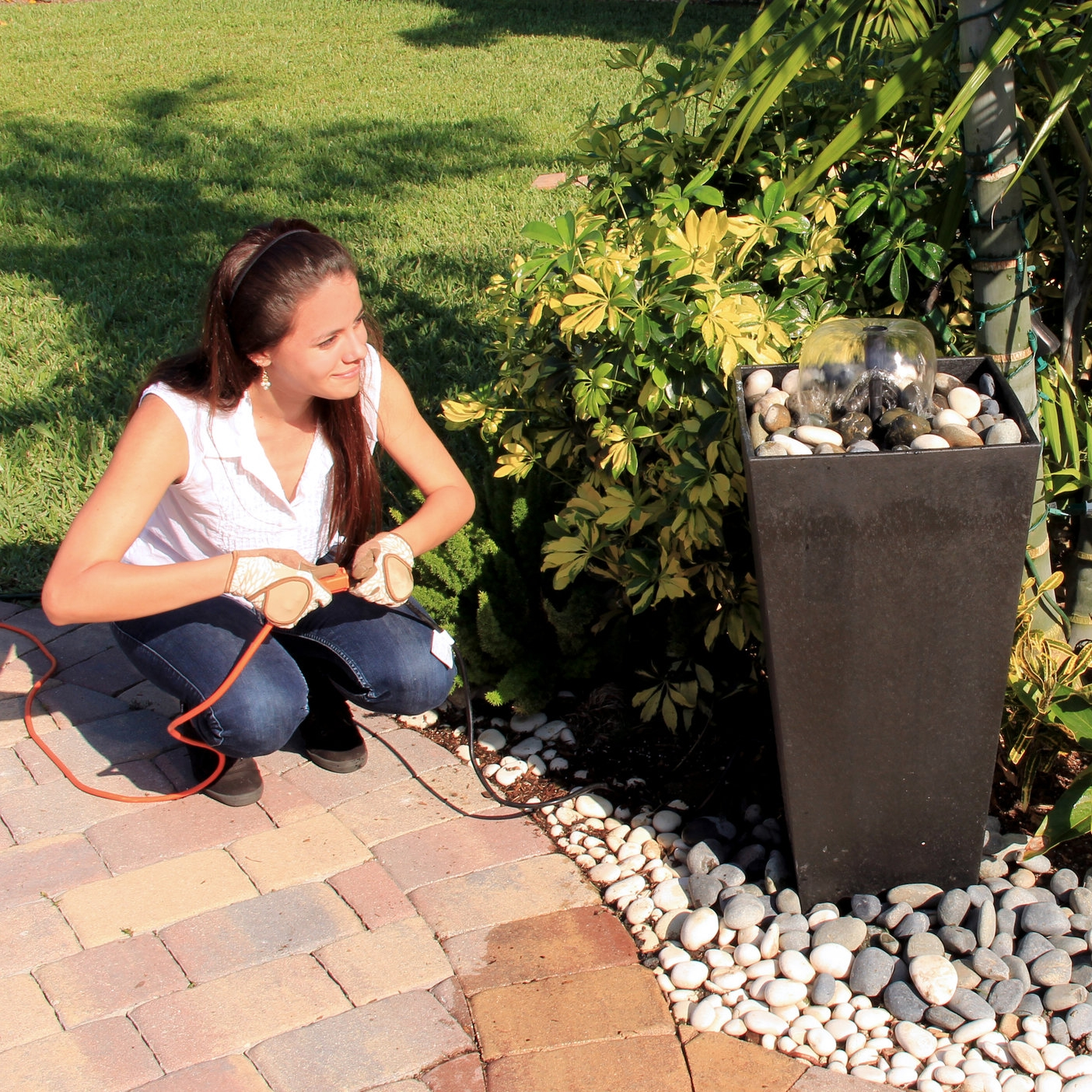 Step 6 - Add pebbles and fill with water. Once the pump is fully submerged, plug it in and enjoy!