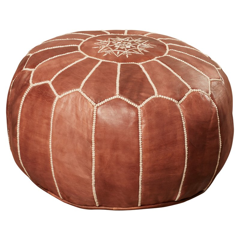 Carolos Leather Pouf - Wayfair.com has a MUCH more reasonable leather pouf for just under $120. Prop your feet up or add extra seating with this great find!