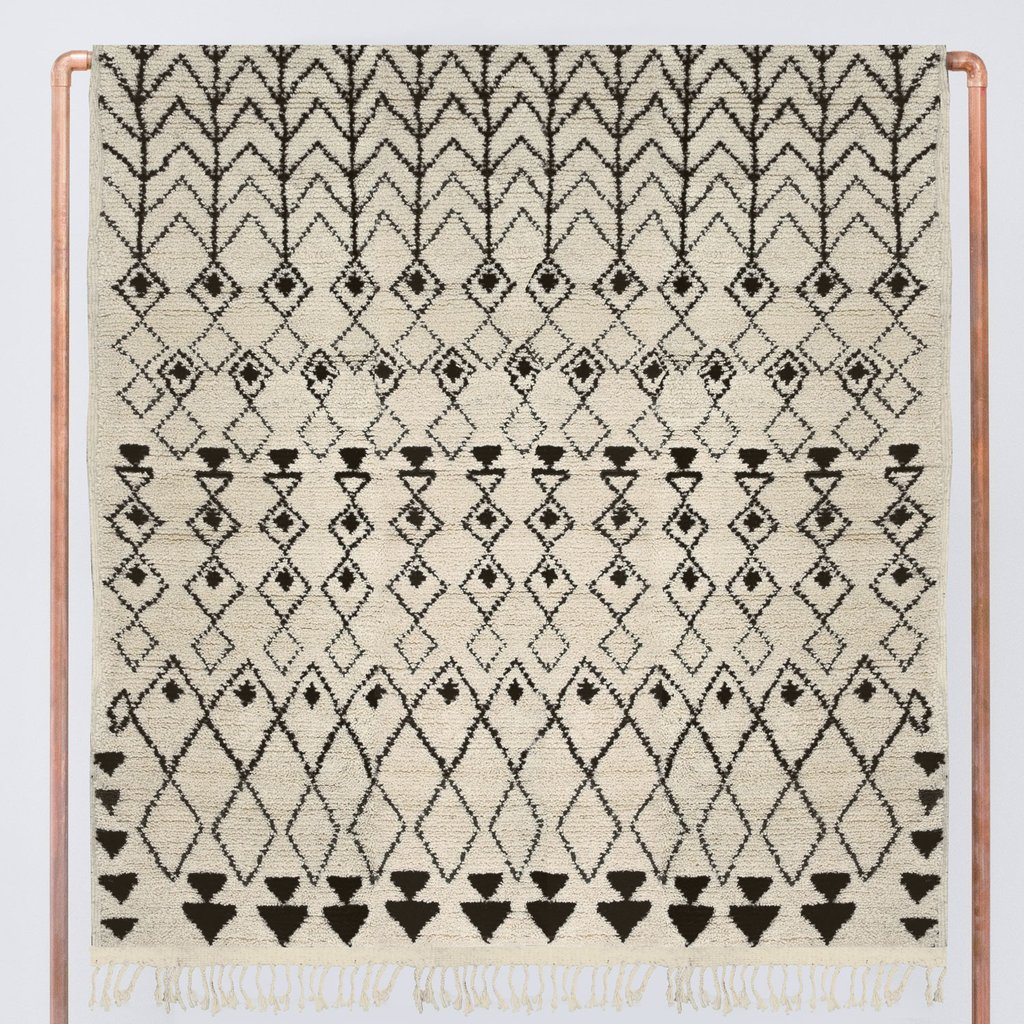 Amal Beni Ourain Rug - A co-worker found this rug and said it would completely tie her whole living room together. She was devastated when the price was WELL above her budget at $2,275...