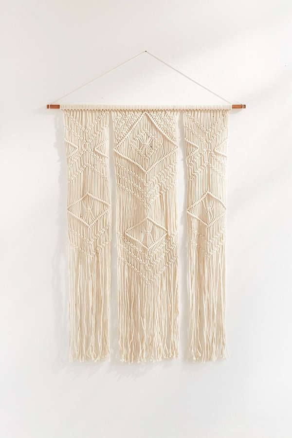 Thank goodness for Urban Outfitters. - This $59 macrame piece is utterly beautiful, will surely captivate house guests & you will be without all the buyers remorse.