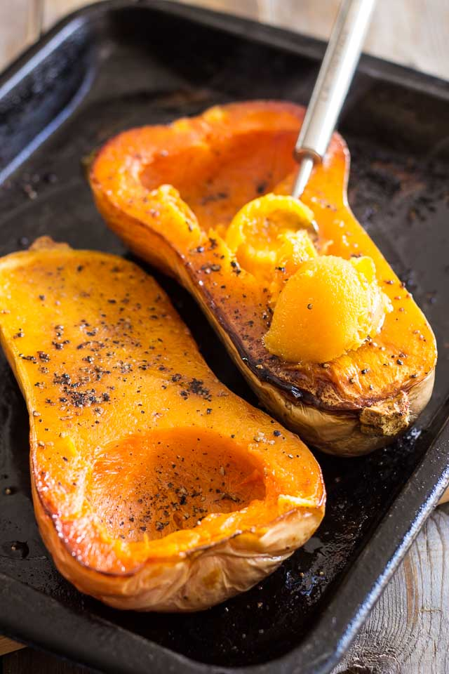 Oven Roasted Butternut Squash - Just gimme a fork, top them with some ghee & stay out of my way. I could eat my weight in these suckers.Pair with some yummy pork chops, top with dried cranberries, or sprinkle with brown sugar...I'll take them anyway I can get them!Really, the possibilities are endless...I'm looking forward to making my own soup from the left overs (if there are any!)by adding some coconut milk & a few spices.