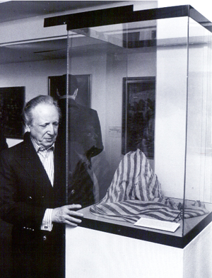Peering at the pants he wore 55 years ago at the showing of his art at The Yeshiva University Museum in 1998.