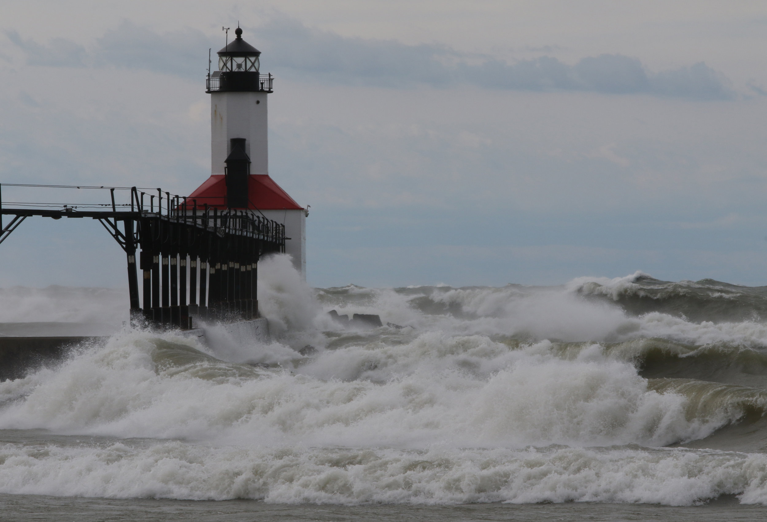 Waves batter the pier by the Michigan City, Indiana lighthouse.