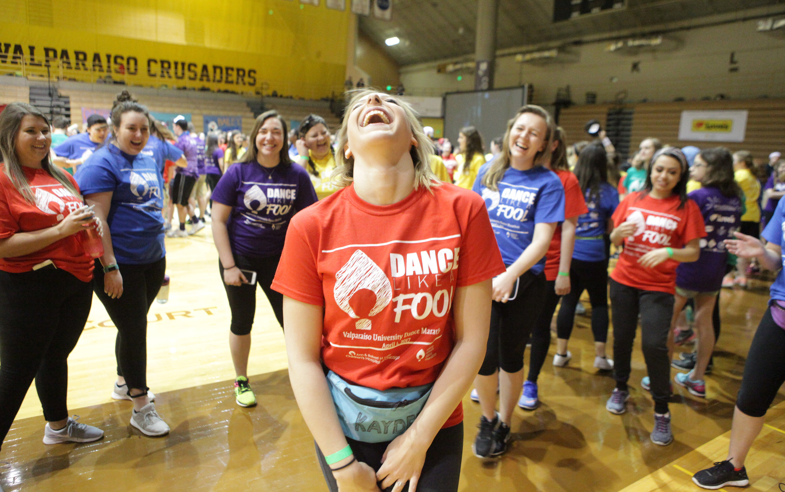 Jorie Pudil, a student at Valparaiso University, has a laugh while dancing during the Valparaiso University Dance Marathon at the Athletics-Recreation Center.