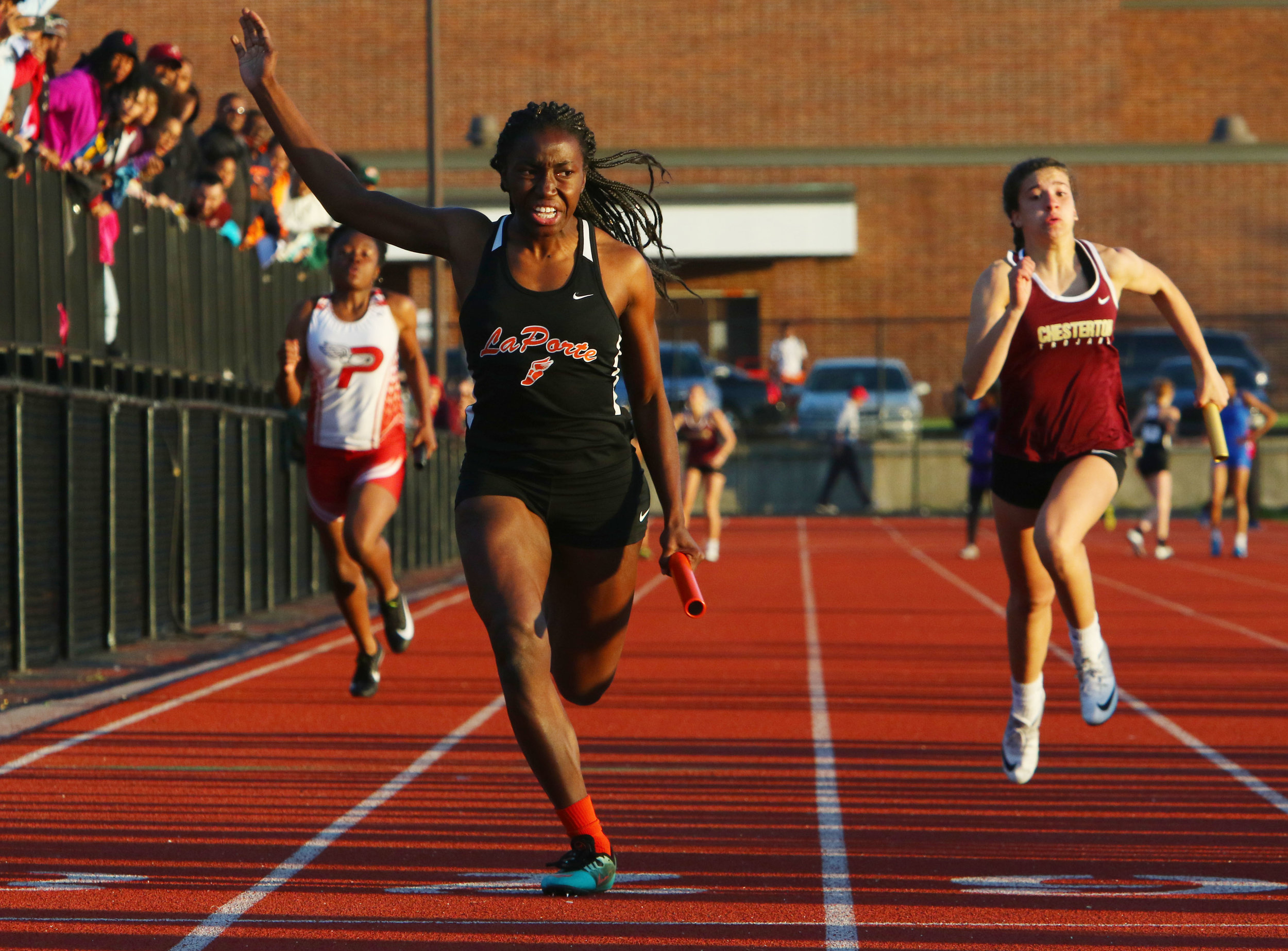 LaPorte's Nichole Flowers, center, powers through to the finish line in the 400 meter relay during girls track regionals at Portage.