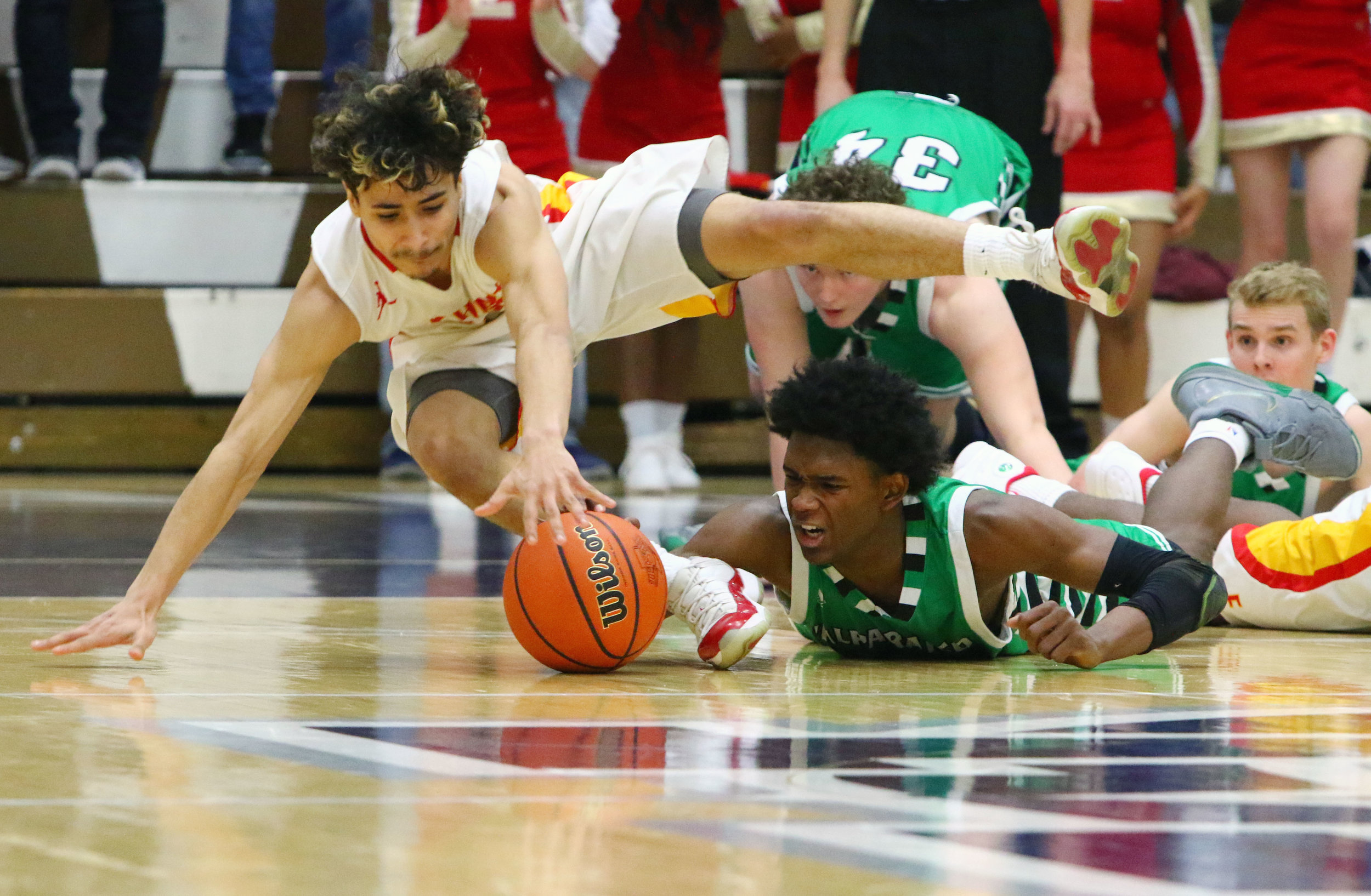 Valparaiso's Brandon Newman, right, and Elkhart Memorial's Jose Soto scramble for a loose ball in Michigan City. The play would result in Newman fouling out of the game.