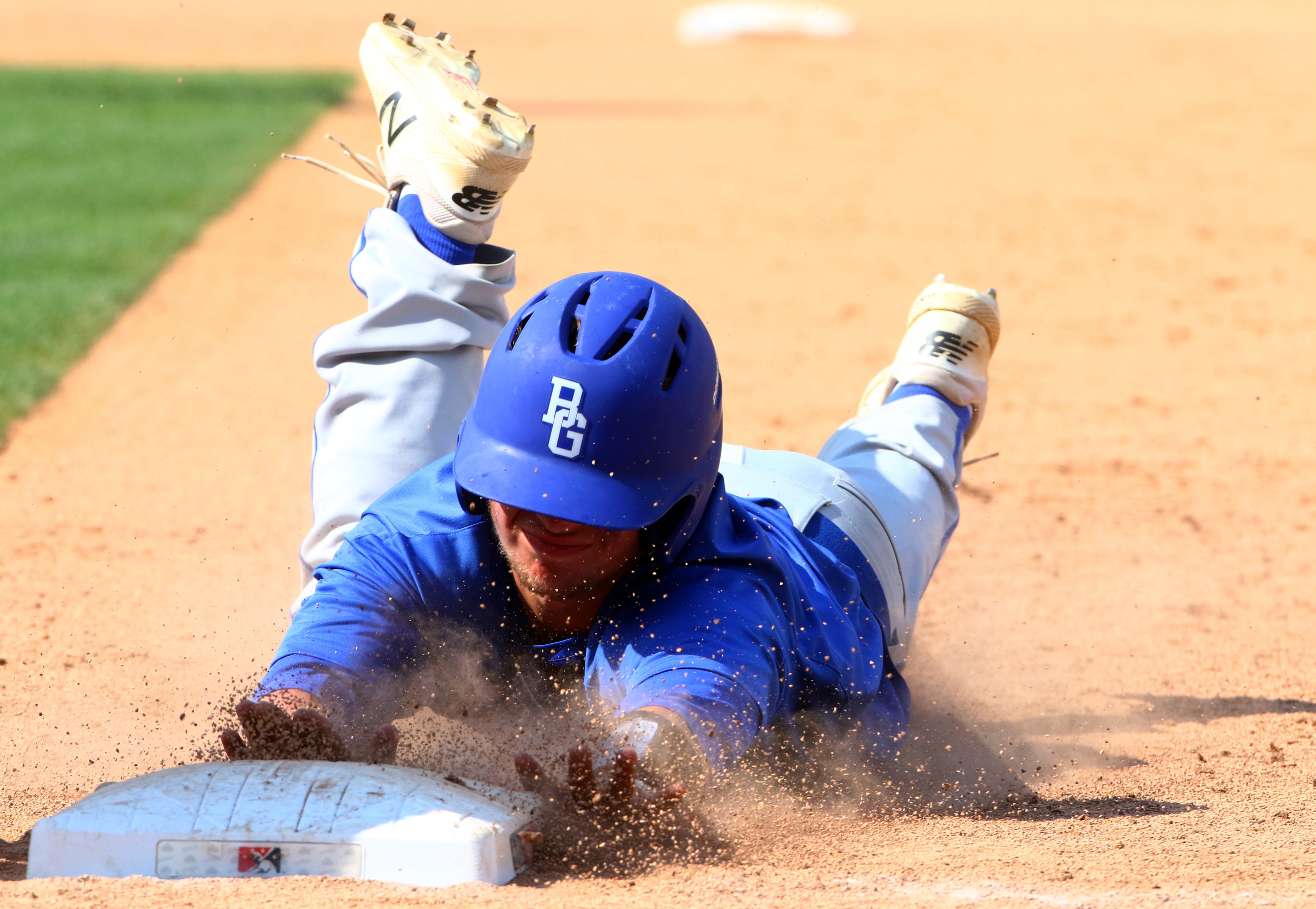 Boone Grove's Dylan Paul dives back to first to avoid the pickoff in the Class 2A state championship game against Southridge at Victory Field in Indianapolis.