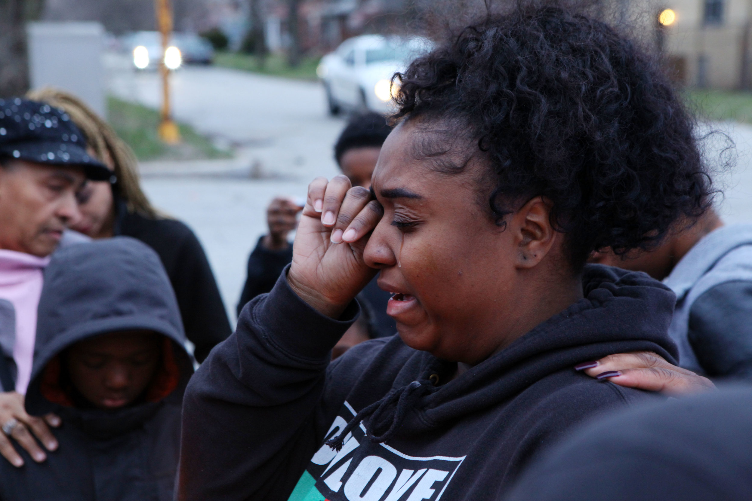 Shuntaya Rogers, of Lake Station, sheds tears as she speaks during a candlelight vigil for her brother, Markis Square, in Gary.