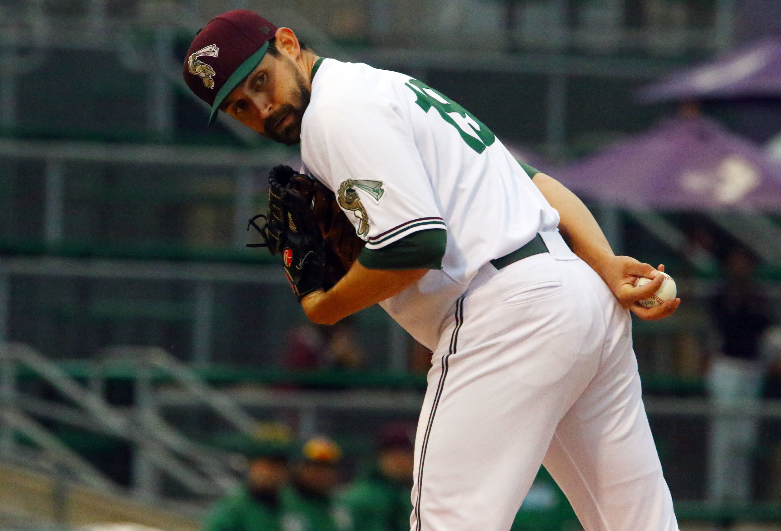 Gary's Daniel Minor peeks back at first base before pitching against the St. Paul Saints in Gary.