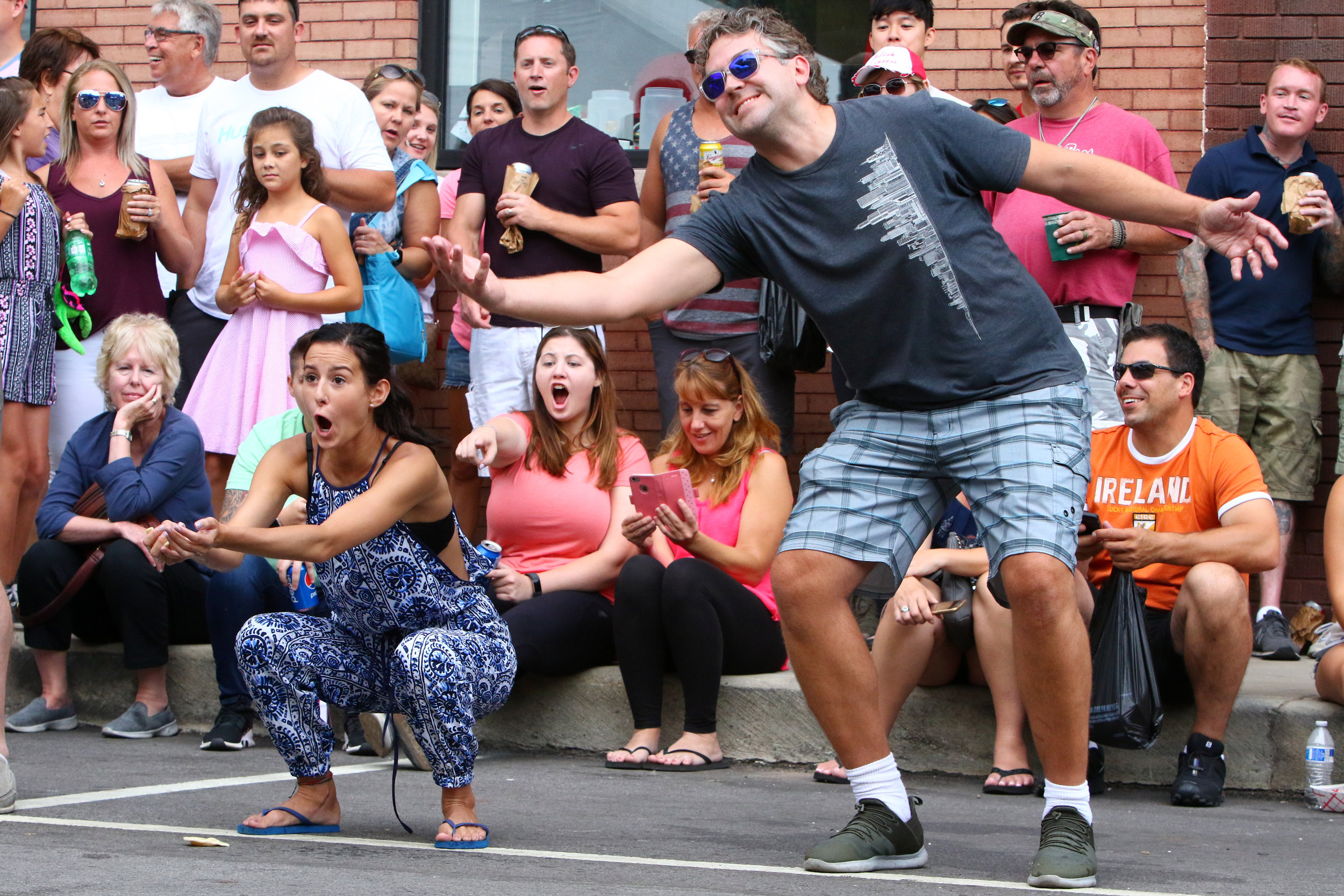 Natalia Rys, left, of Chicago, reacts after catching her pierogi and successfully winning Pierogi Fest's pierogi toss Sunday in Whiting. Rys was won with her partner, Rolando Araujo, also of Chicago.