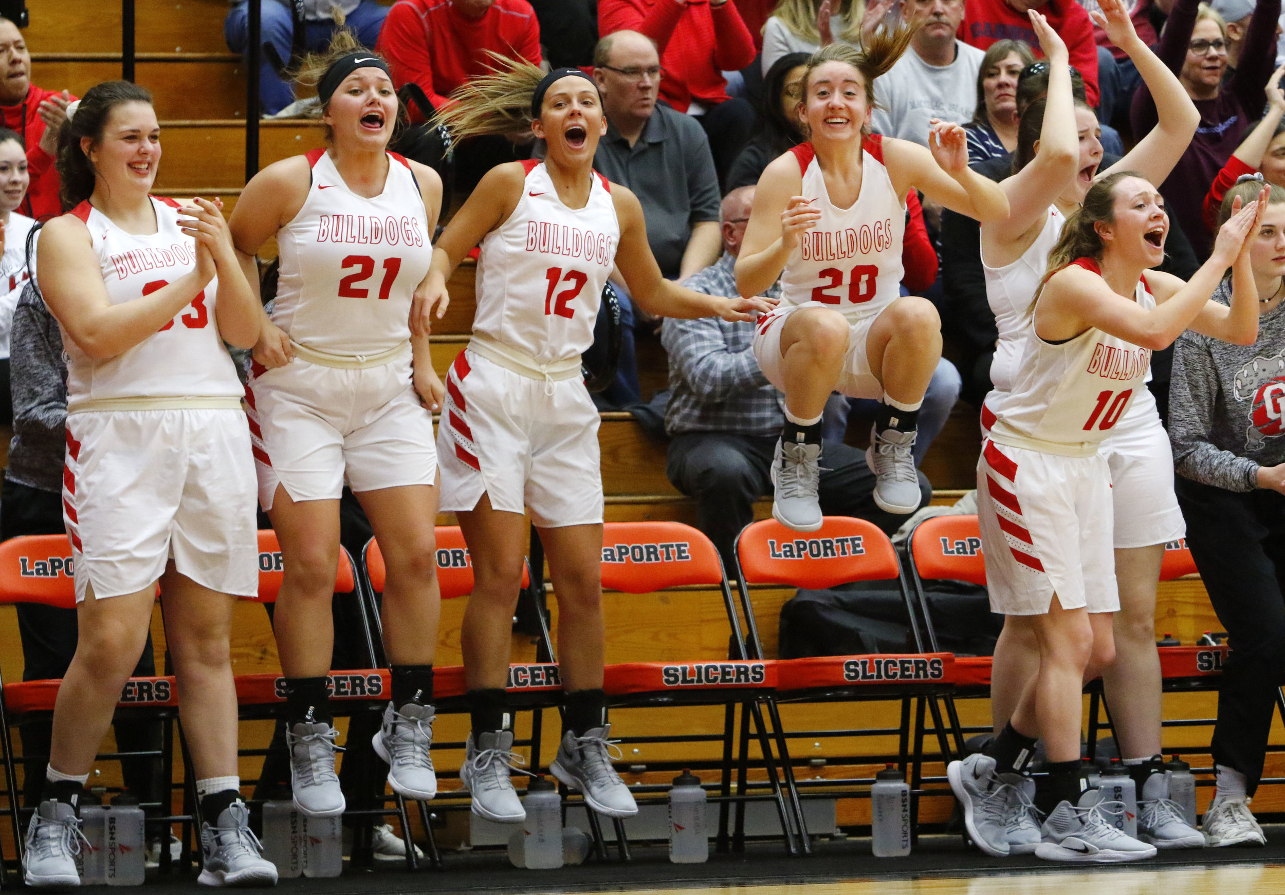 Crown Point's bench reacts after the team scored against Penn during a Class 4A regional final at LaPorte High School.