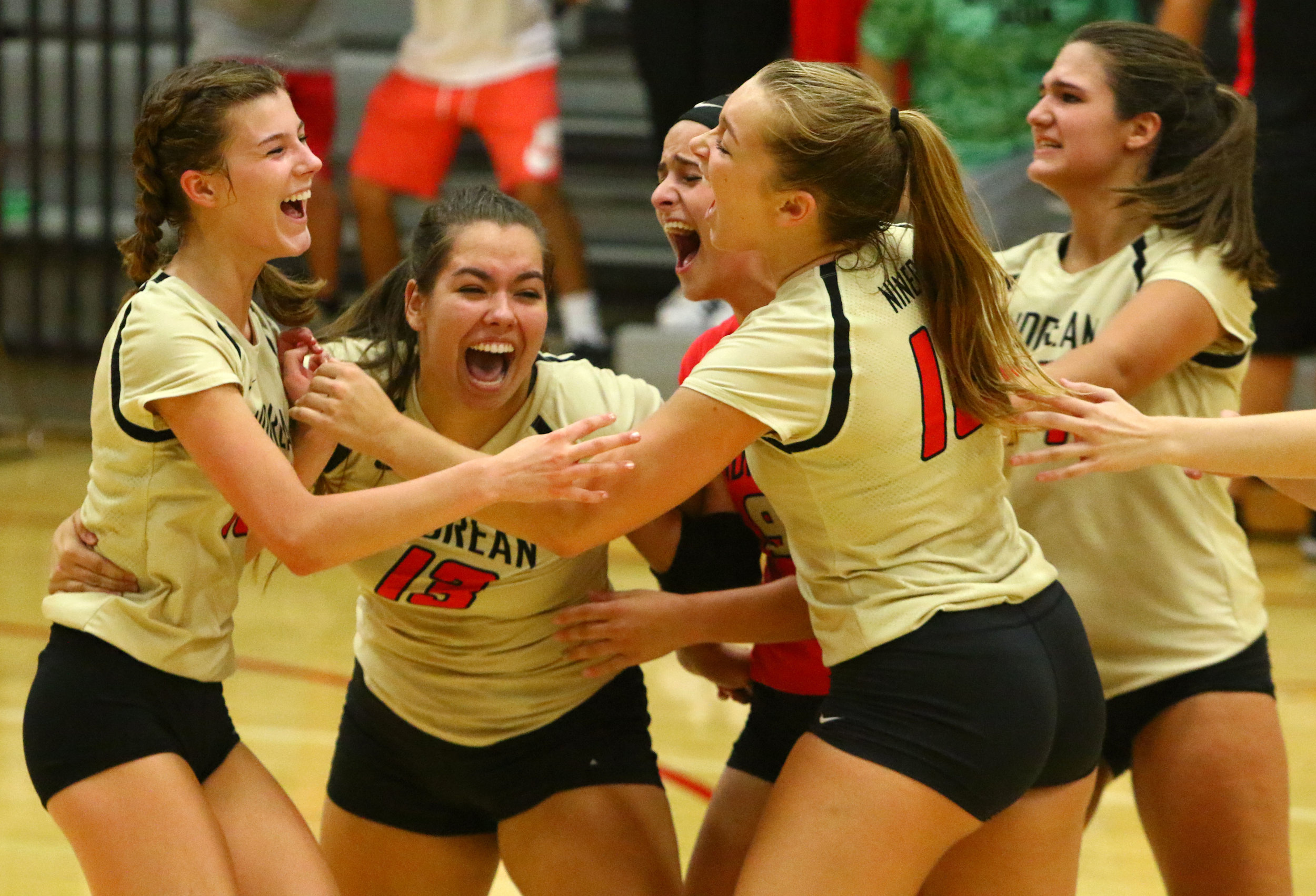 Andrean players react after scoring against Bishop Noll in Merrillville.