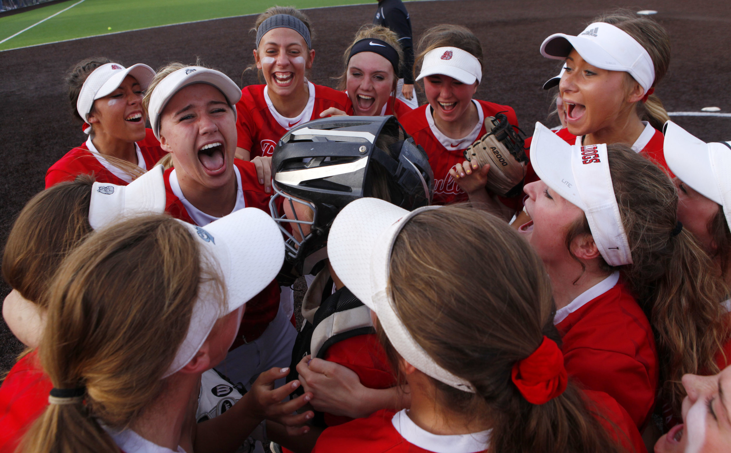 Crown Point players celebrate their 2-0 sectional championship win over Lake Central in St. John.