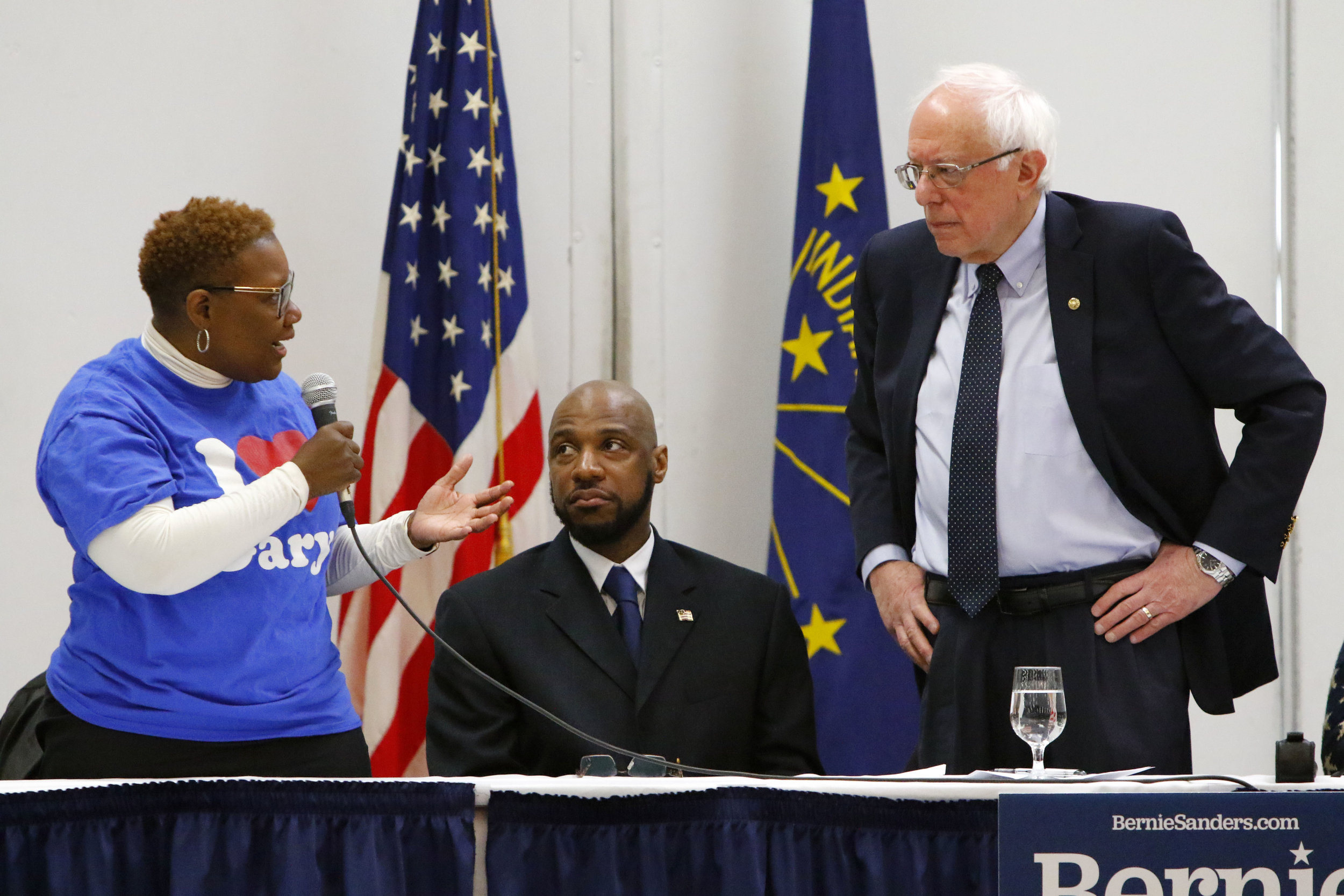 Gary Mayor Karen Freeman-Wilson, left, speaks to U.S. Sen. Bernie Sanders, I-Vermont, at the Genesis Convention Center during a meeting with community leaders. Seated between them is Ron Brewer, Gary councilman at-large. Sanders made other stops in Wisconsin, Michigan, Pennsylvania and Ohio.
