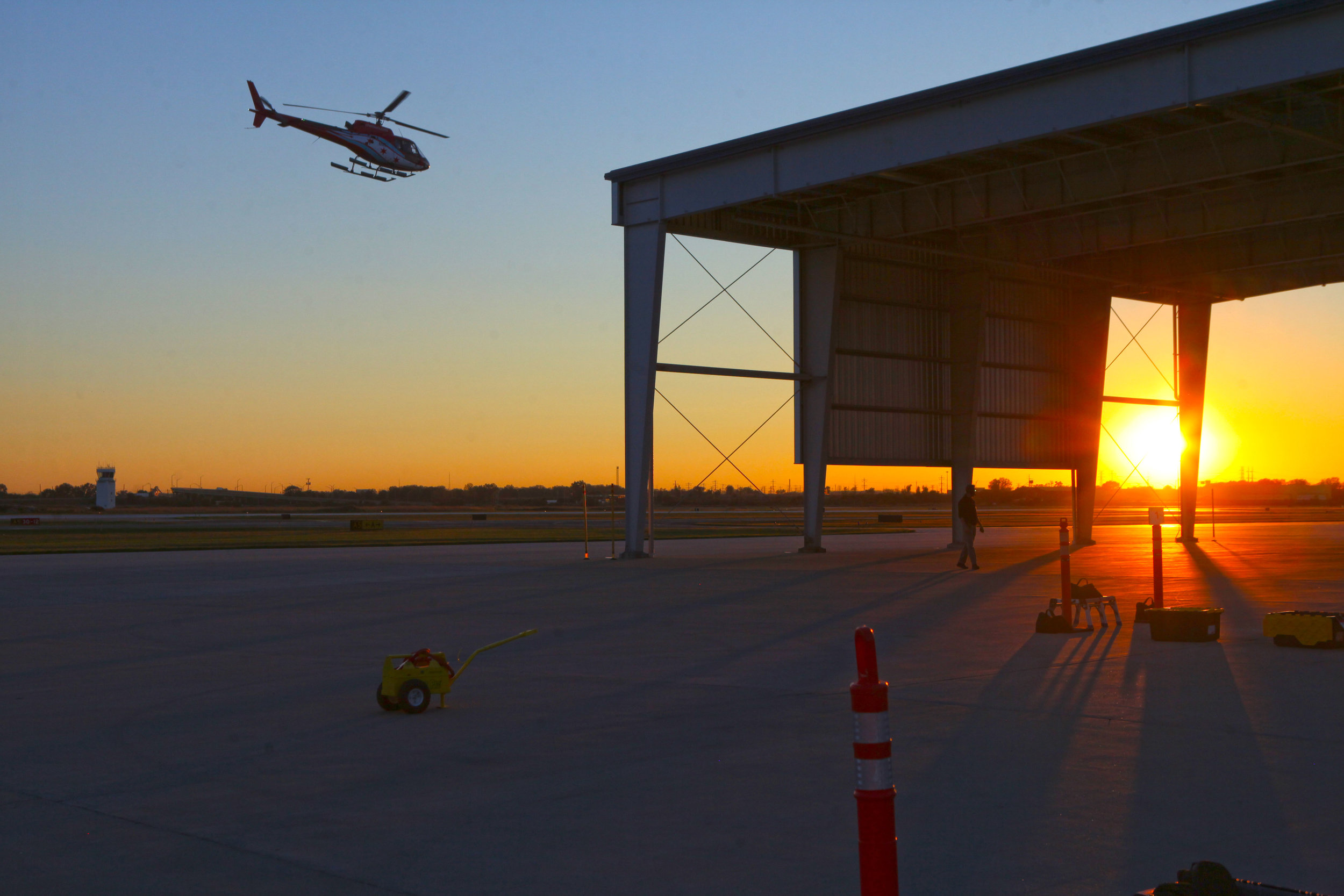 The sunset is seen from Gary/Chicago International Airport during the Night of Flight hosted by the Boys & Girls Club of Greater Northwest Indiana.