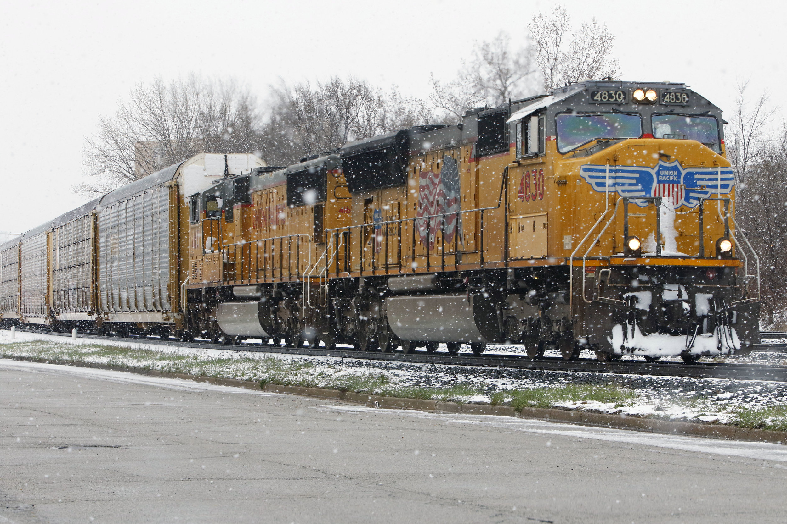Union Pacific locomotives pull freight through snow along Willow Court in Hammond.