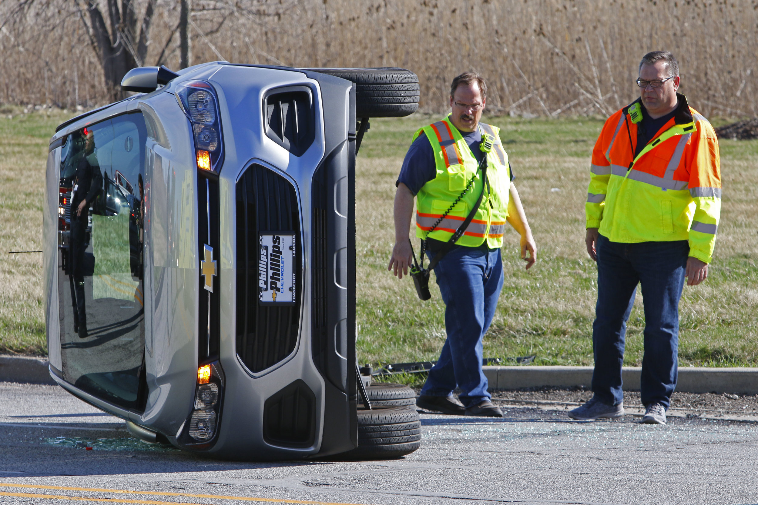 First responders work a scene on 45th Street in Munster where a silver car ended up on its side.
