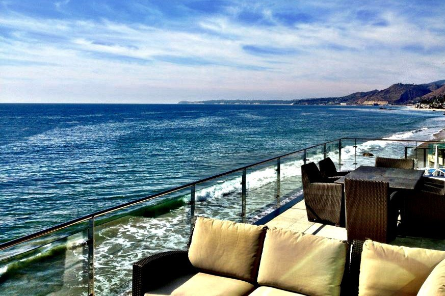 This high-concept Malibu home possesses an outdoor living room situated directly over the beach waves.