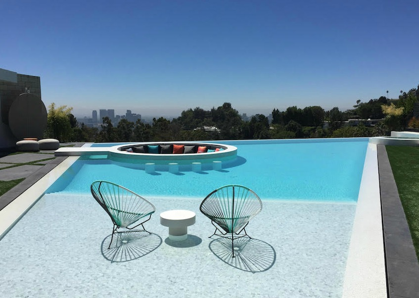 Retro-inspired   : This mid-century inspired home in the Trousdale neighborhood of Beverly Hills showcases a fire-and-conversation pit within the swimming pool.