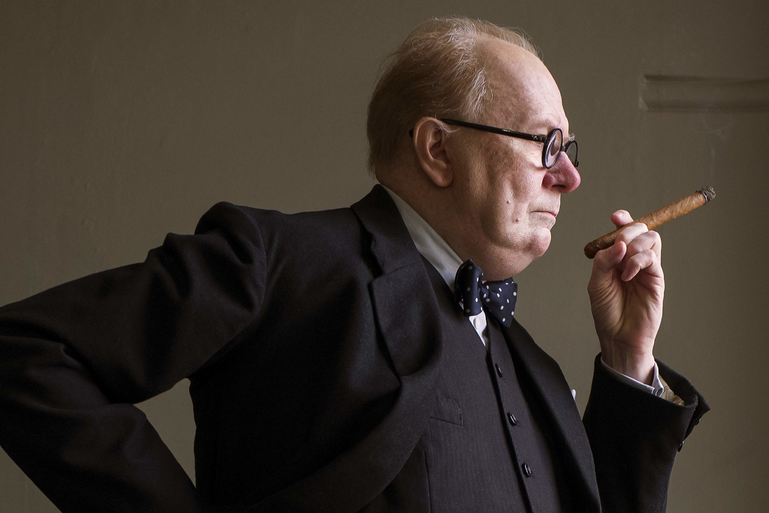 "12. GARY OLDMAN | as Prime Minister Winston Churchill | DARKEST HOUR   ""(Initially) I turned it down. You're stepping into Richard Hardy's shoes, Albert Finney's shoes, Michael Gambon's. And, of course, the silhouette. You look at me, and I probably could have a good crack at Stan Laurel.  What I did was to push all of that aside and go to the source material, the [1940] newsreel footage. He's often thought of as this grumpy curmudgeon born in a bad mood, with a whiskey and a cigar, and he shuffles in. And what I saw, what jumped out of this old, jittery black-and-white footage, was a man who was 65 but moved like a 20-year-old. He moved through space with a fixity of purpose. He had this cherubic face with sort of a naughty schoolboy grin, with a sparkle in his eye.  I was born in 1958, and of course Churchill was our hero — I guess our savior. The man who won the war. My mother's 98, went through the blitz; my dad was in the Royal Navy at the battle of Okinawa. One feels a connection there. But I'm constantly amazed discovering things about Churchill. I was surprised to find when I read the script was just how close we came to losing. Eventually, we didn't do a deal with Hitler. I could forgive perhaps the Americans for not knowing the history, but I thought it was interesting that in Britain a lot of the people also didn't know any of the details of the story. That is something to take away from the film, to realize just how perilously close we came right down to the wire."" -  AARP, November 21, 2017"