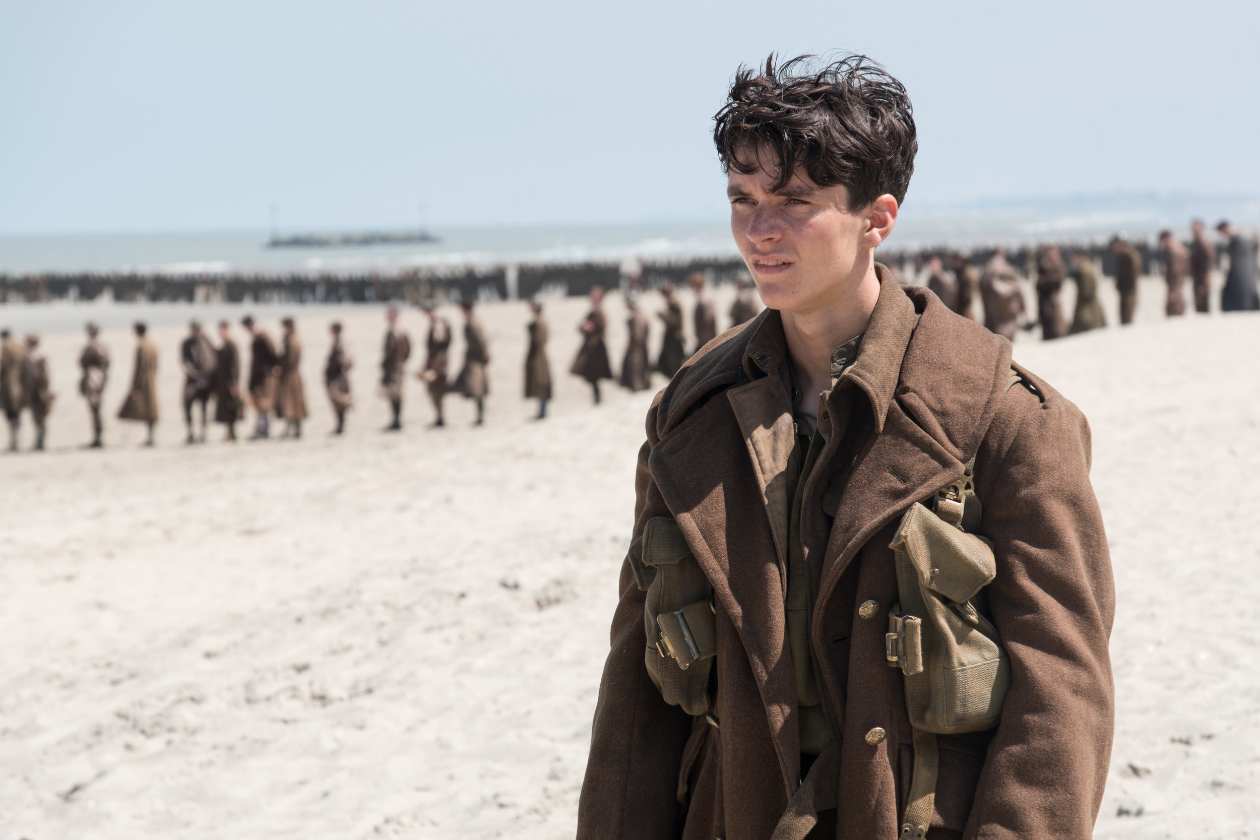 "3. DUNKIRK | Directed by Christopher Nolan | Release Date: July 21, 2017   A war film unlike any other we have seen before, Christopher Nolan's disorienting, exceptional, masterful  Dunkirk  tells us a World War II story from three different perspectives - by ground, by sea, and by air. Told in a non-linear style, until the three stories converge upon one another unexpectedly, and with breathtaking results, Nolan has left science-fiction and fantastical adventure and gotten gritty. The results are astonishing.   Dunkirk  doesn't play by conventions. A main character doesn't have a name for the first 30-40 minutes. Discussions of war-time decisions lack context, with most viewers perhaps confused by what is being discussed, since the rescue of 400,000 British military soldiers is not a commonly known tale in the United States. A man, with his sons, navigates a personal yacht with supplies to try and aid in the rescue efforts. Soldiers are forced to band together, never having a thought in questioning loyalty or ""sides."" And a fighter pilot is in near constant battles with German pilots coming in from seemingly every angle.  Nolan places us in the confusing fog of all of these situations. We go from day-to-night and things feel haphazardly constructed, things may seem sequenced wrong. Nolan orchestrates a lyrical cadence to this war. He builds to a final act like a symphonic composer hitting a crescendo at just the right moment. Suddenly, we understand everything that is happening, the stakes feel real, our hearts are in our throats, and we simply hold on and ride this thing out until Nolan decides to take his foot off the accelerator.   Dunkirk  will likely rank among the best films of the decade as we move past 2017, and Nolan's ability to take us on a journey is unparalleled."