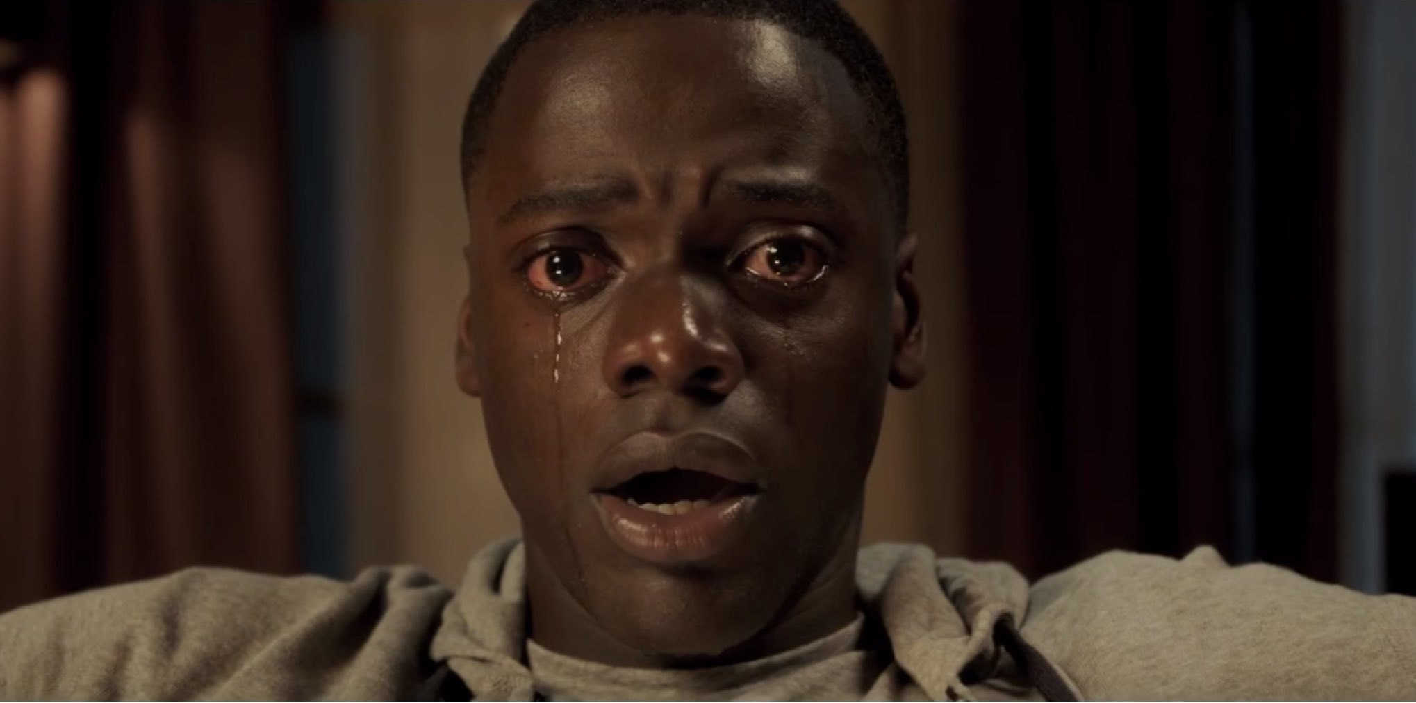 "1. GET OUT | Directed by Jordan Peele | Release Date: February 24, 2017   Jordan Peele's directorial debut,  Get Out,  radiates brilliance. It is a fearless, ambitious, bold psychological suspense/horror film that balances deft comedy flourishes with palpable intensity, moments of honest psychological horror, and great suspense. Quite simply, he has delivered one of the finest debut films of recent memory.  Moreover,  Get Out  is just exceptionally well made in every way. Serving up an outlandish and exaggerated premise, commonplace with domestic horror films, he slowly turns the camera around on us, the viewers, forcing us to ask difficult questions about our perceptions and values, allowing us to openly wonder why we are reacting and responding to the images and developments he places before us.  The late author and journalist, Molly Ivins, once wrote that ""satire is traditionally the weapon of the powerless against the powerful,"" and Peele wields his weaponry (a pen, a camera, a voice) with such precision-like skill that it may take a minute before you realize he is wryly showing us who we have been and who we are.  Another quote comes to mind from British author Aldous Huxley: ""Facts do not cease to exist because they are ignored.""   Get Out , nearly one year after it's debut, still shakes people up. We are still discussing it in 2018. Come for the horror, stay for the horror of reality. We hear all the time how horror films are a reflection of society at large, and people bend over backwards finding ways to defend and elevate the genre, giving it depth and meaning.  Peele walks the walk and if you can't hear his message, perhaps you haven't been listening in the first place."