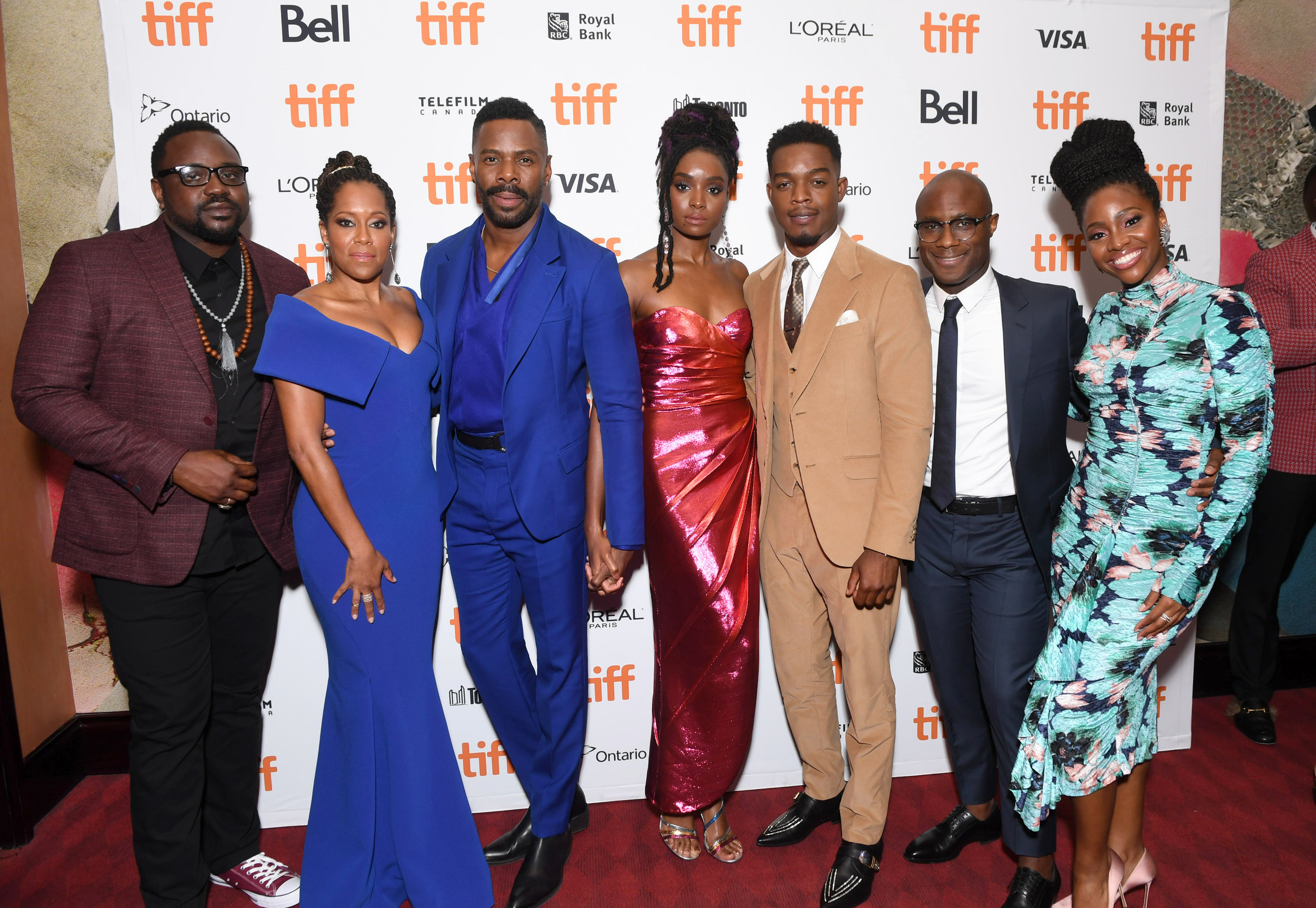 """13. THE CAST OF """"IF BEALE STREET COULD TALK"""" (L-R): Brian Tyree Henry, Regina King, Colman Domingo, KiKi Layne, Stephan James, Teyonah Paris Also pictured: Writer/director Barry Jenkins Not pictured: Aunjanue Ellis, Michael Beach    Adapted from James Baldwin's 1973 novel, a young African-American couple face an uncertain future, expecting their first child, while the father is incarcerated for a crime he never committed.    (writer/director Barry Jenkins):  """"This movie was definitely harder than  Moonlight . For 8,000 different reasons, but the narrative is slippery, there are way more characters. If there are five words spoken in  Moonlight , there are 500 words spoken in  Beale Street . There are all these different muscles that I haven't had to work out in the past that I had to work out in this film.  The intimacy between the two young persons, and for me that all came down to two actors who would connect in a certain way. I think when you think of chemistry, you think, ' Oh, those two actors just want to tear each other's clothes off .' And that's not what I'm speaking of when I speak of chemistry. I'm talking about two people who feel legitimately connected, whose viewpoints and thoughts dovetail, and I thought that about KiKi Layne (""""Tish"""") and Stephan James (""""Fonny"""").  If it's all anger, all the time, then to me that's dehumanizing in a certain way. There is a child at the end of this journey, and I did not want to have the circumstances of what befalls Fonny to completely consume him. When Regina [King's character, Sharon, Tish's mother] goes to Puerto Rico [to confront Victoria about her accusation against Fonny], if I were making this movie from a place of anger, the scene between the two of them would be very problematic. Because if she went to confront that woman out of anger or bitterness … it frightens me to think of how that scene could have played out.  There's a scene very early in the film where there's an act of domestic violence. Right in the m"""