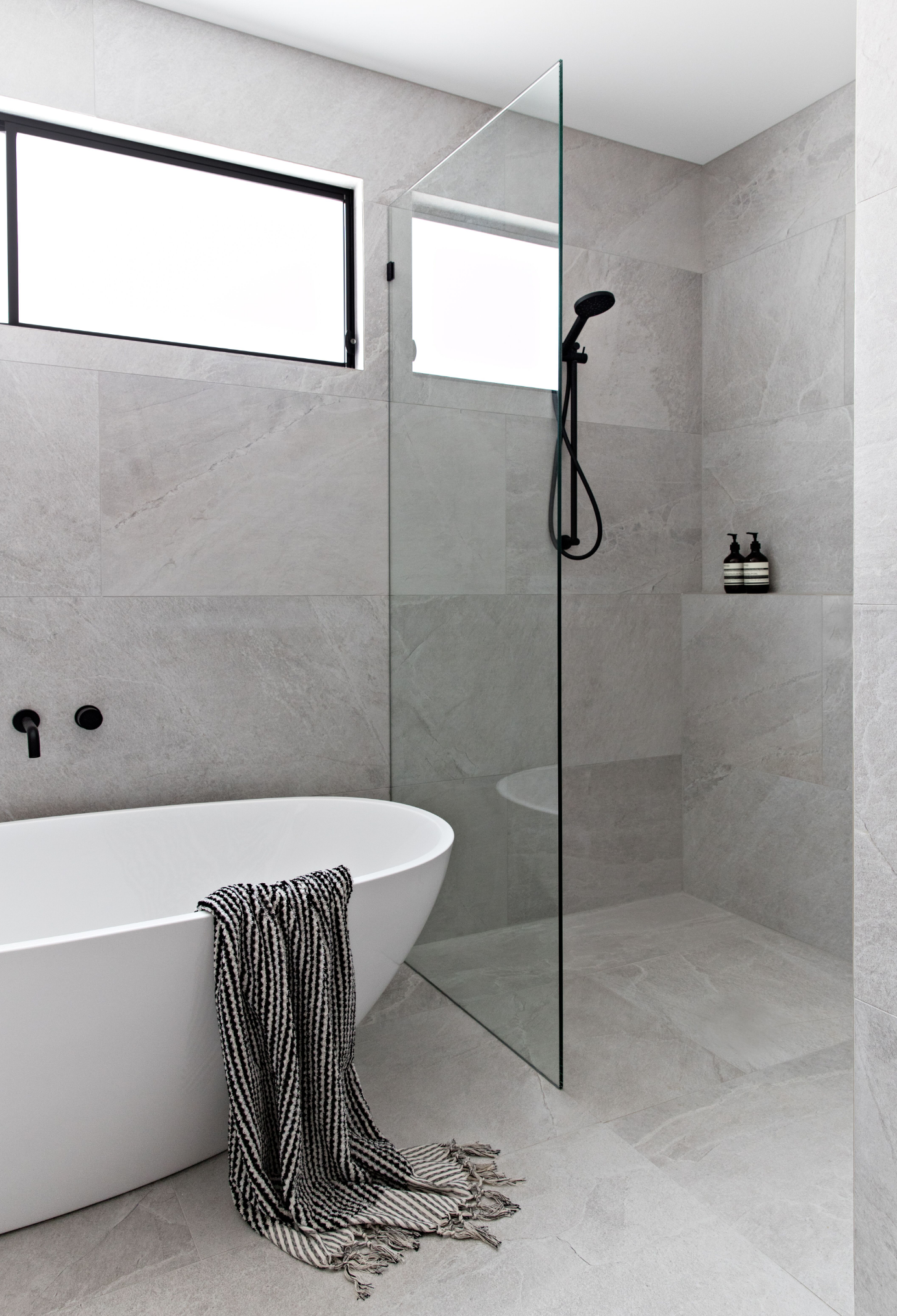 Picking The Perfect Tile Zephyr Stone, White Stone Tile Bathroom