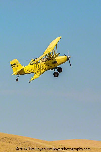 Bi-plane crop duster getting ready to come aroudn and take another pass.