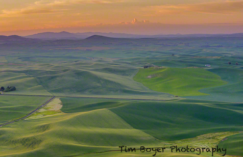 Sunrise from Steptoe Butte on a windy day.  Use teh  car as a wind break and  push the ISO up for a faster shutter speed!