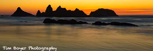 A slow shutter spedd blurs the evening waves.