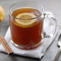 Crockpot Non-Alcoholic Hot Toddy - Ingredients (serves 12):- 4 quarts water- 8 herbal tea bags- 1-2 inches fresh ginger, thinly sliced- 4 cinnamon sticks- ⅓ cup honey- 2 lemons, slicedInstructions:Place water, tea bags, ginger, cinnamon and honey in a crockpot on highest setting. Steep for a couple of hours until hot. Ladle into cups and add lemons when your guests arrive