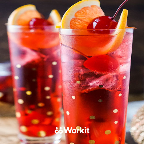 red sherry temple mocktail with orange and cherry garnish