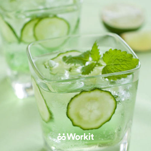iced drink with cucumber and mint garnish