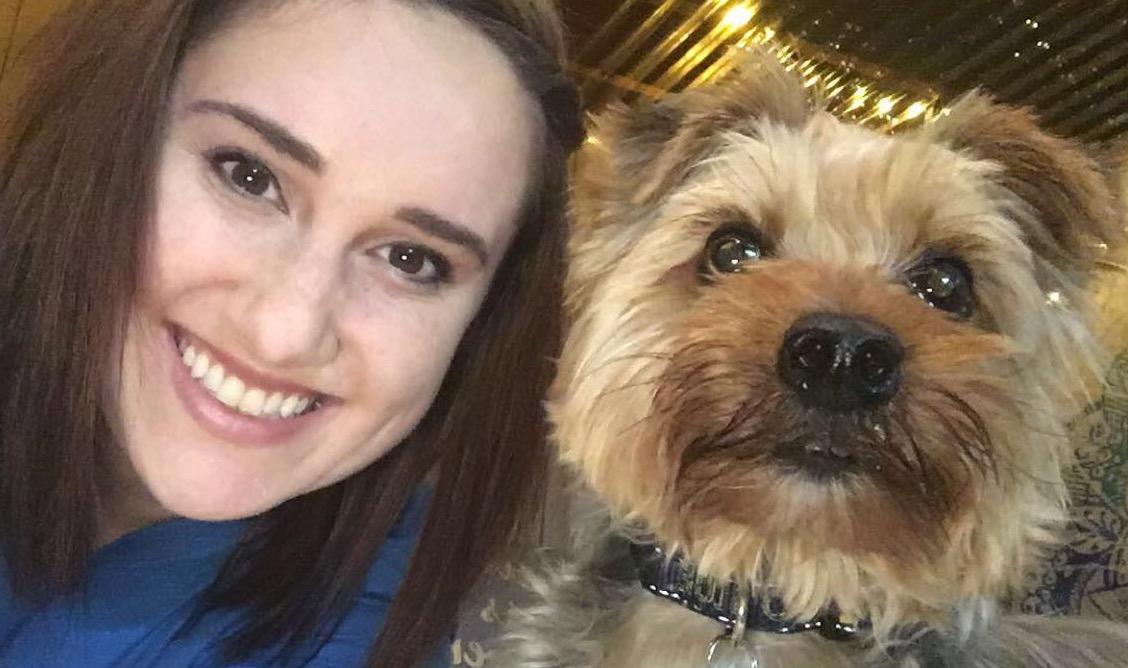 Digital Marketing Coordinator Courtney with her Yorkshire terrier