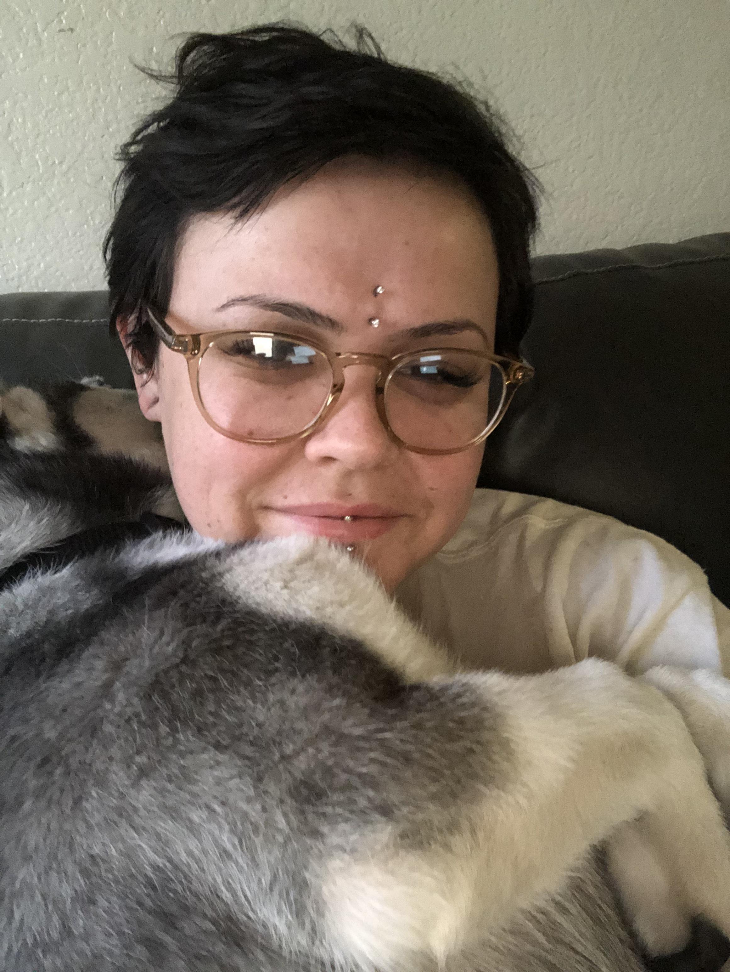 Intake coordinator Corissa hugs her dog