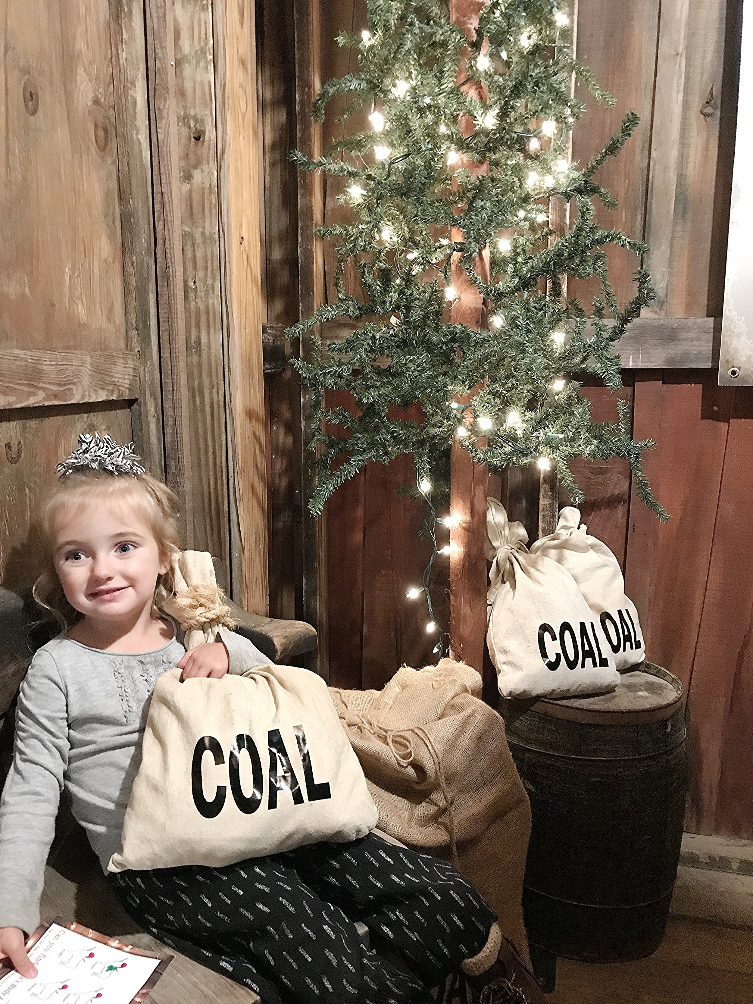 girl holding coal.jpg
