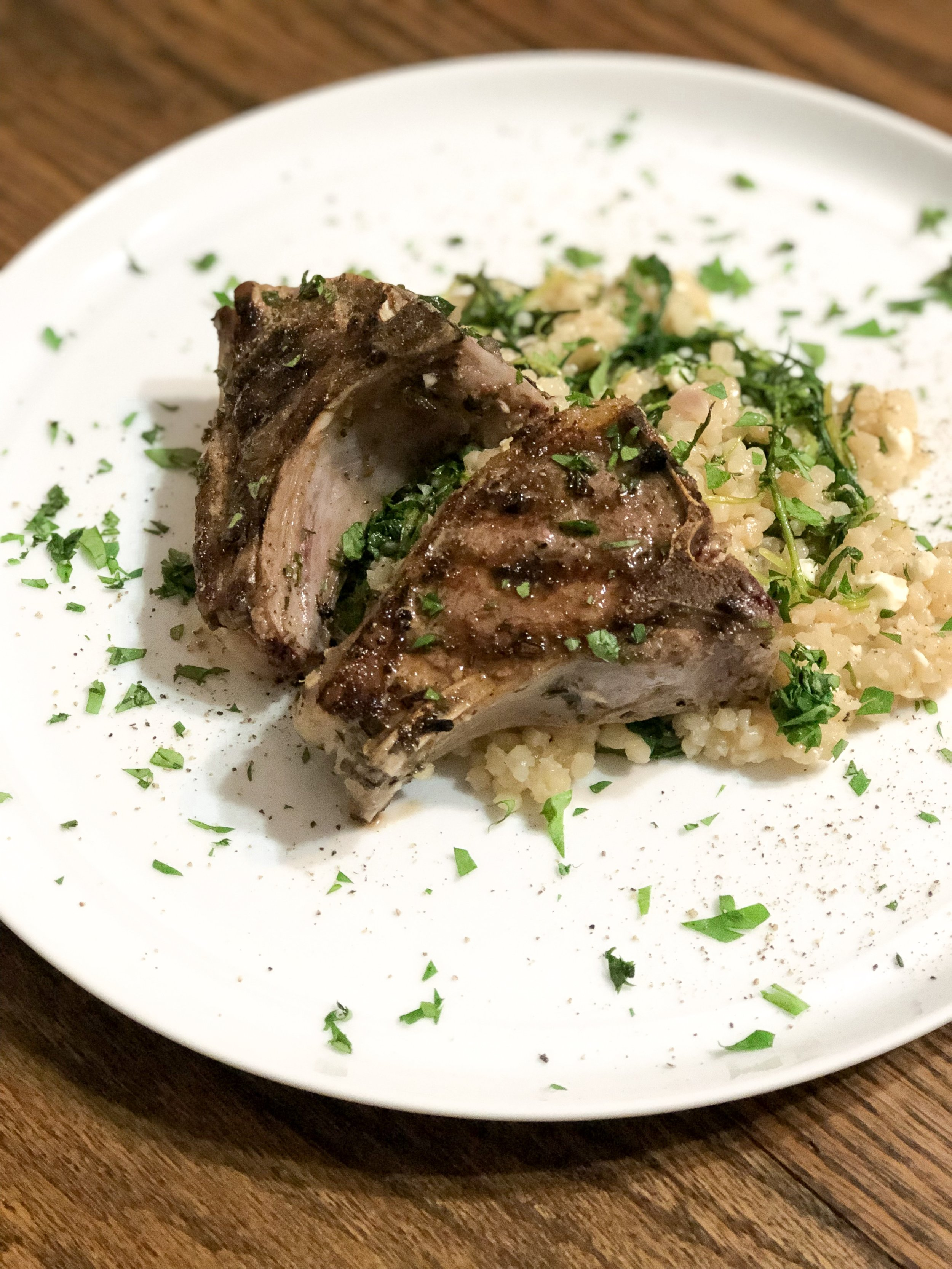herb marinated lamb loin with cous cous arugula salad -