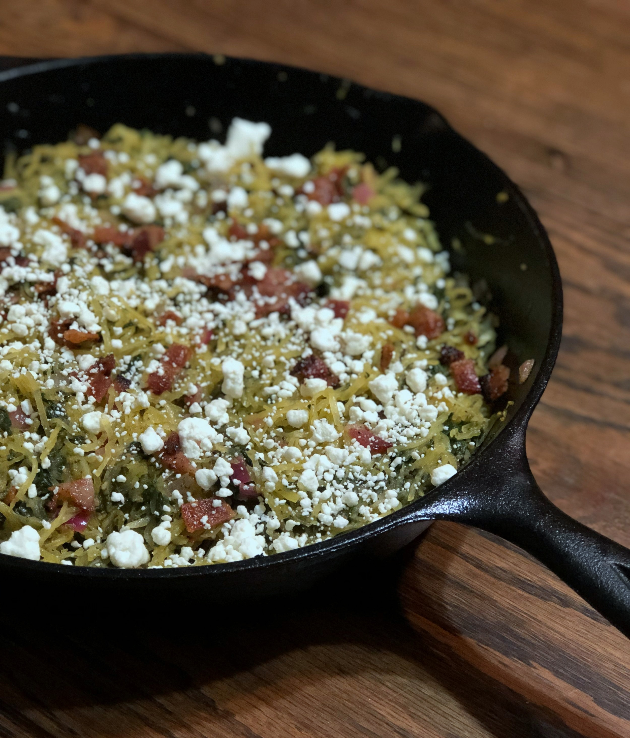 cast iron spaghetti squash with bacon, spinach, and goat cheese -