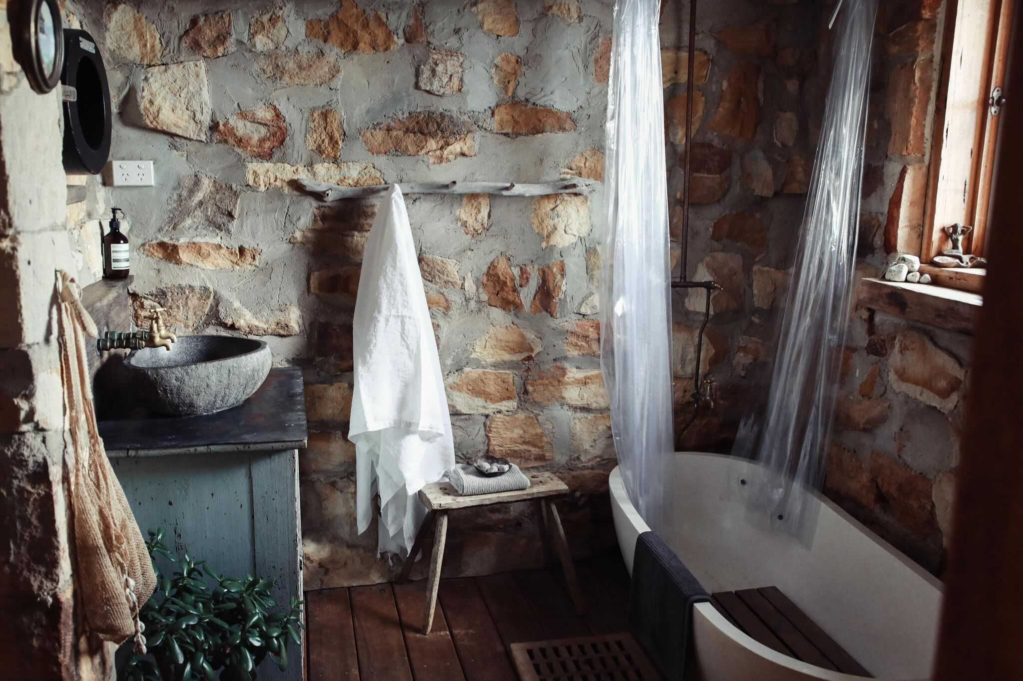 Sandstone and timber bathroom