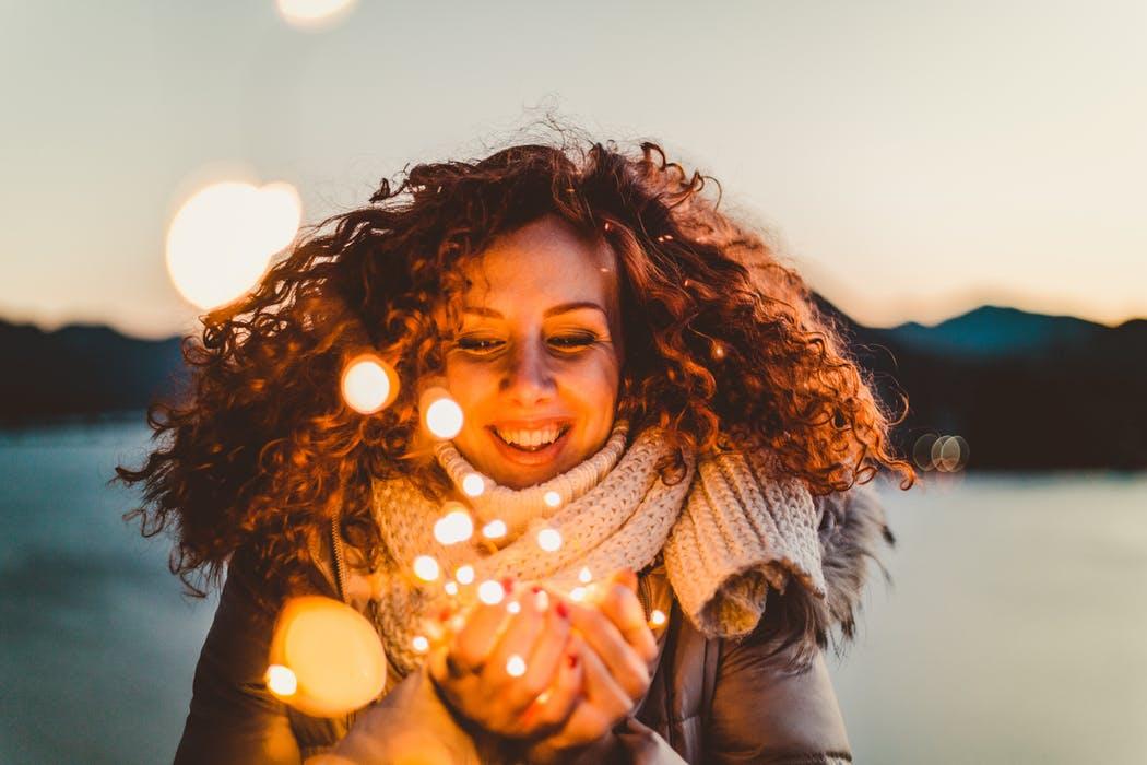 woman lights smiling.jpeg