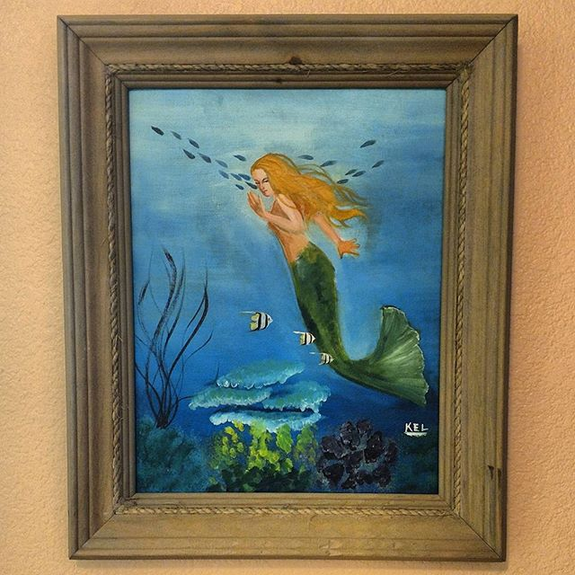 My first painting on canvas that I ever did. I was a child. To this day I still love mermaids!