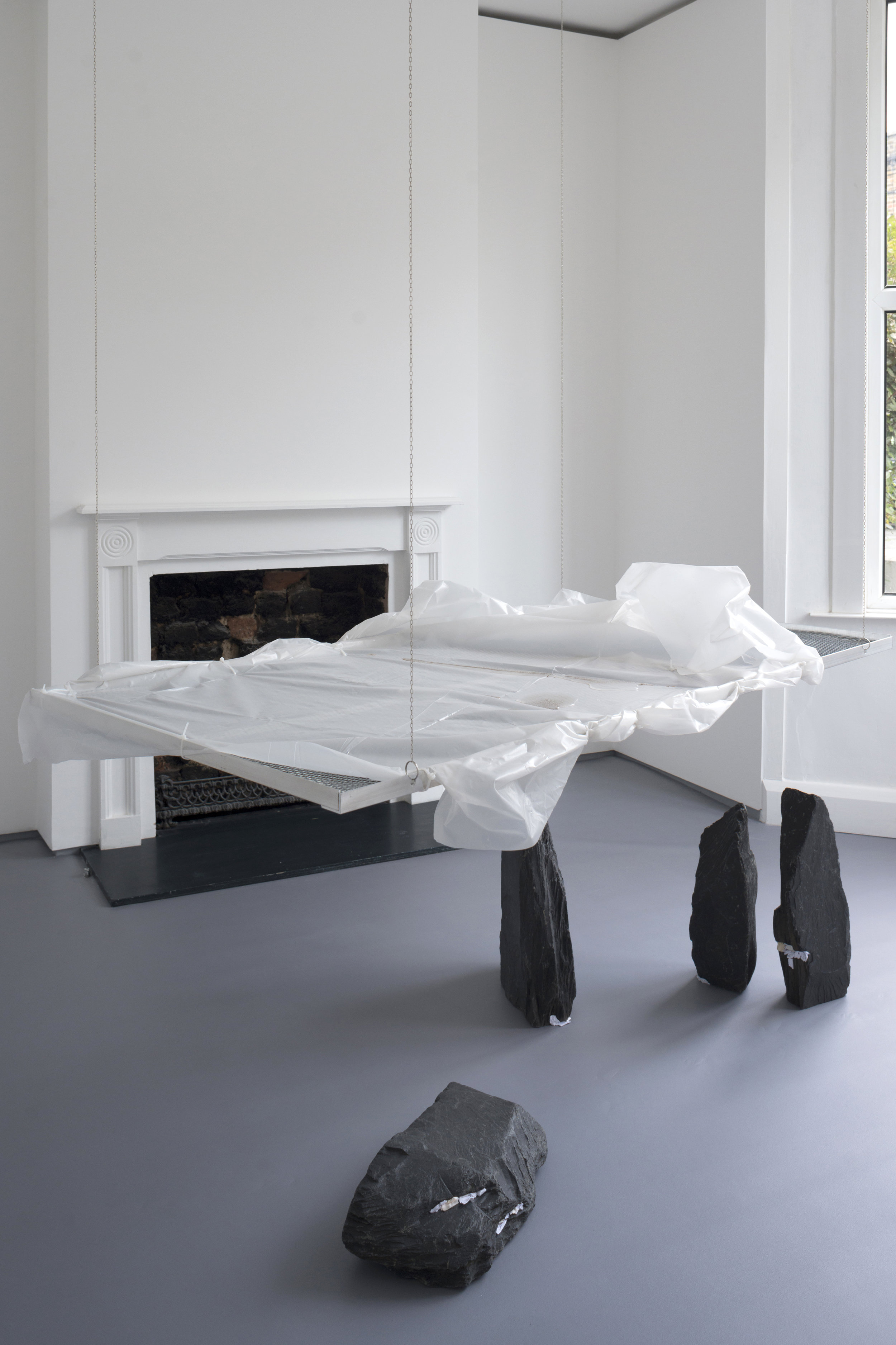 Drift, 2017 Aluminium, cable ties, plastic sheet, steel mesh and mop water; and slate with folded paper  155 x 80 x 2.5cm; and dimensions variable