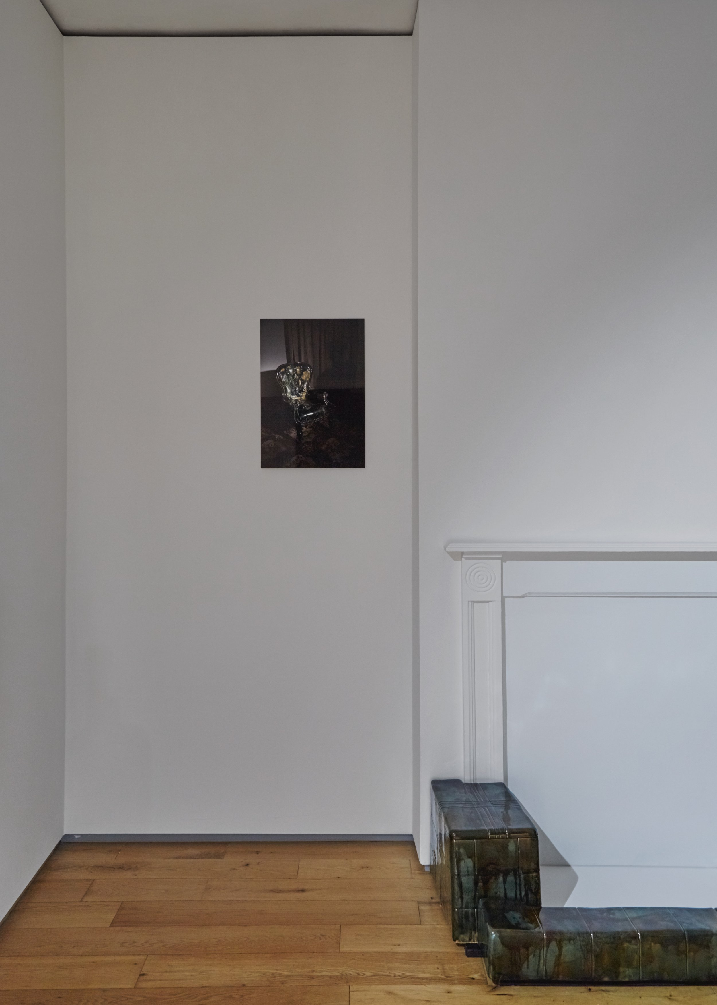 Visitor,  2019 Fujiflex print on aluminium dibond 36 x 50 cm   Strange Comfort (fire surround),  2019 Stoneware ceramic and glaze 28 x 135 x 52 cm