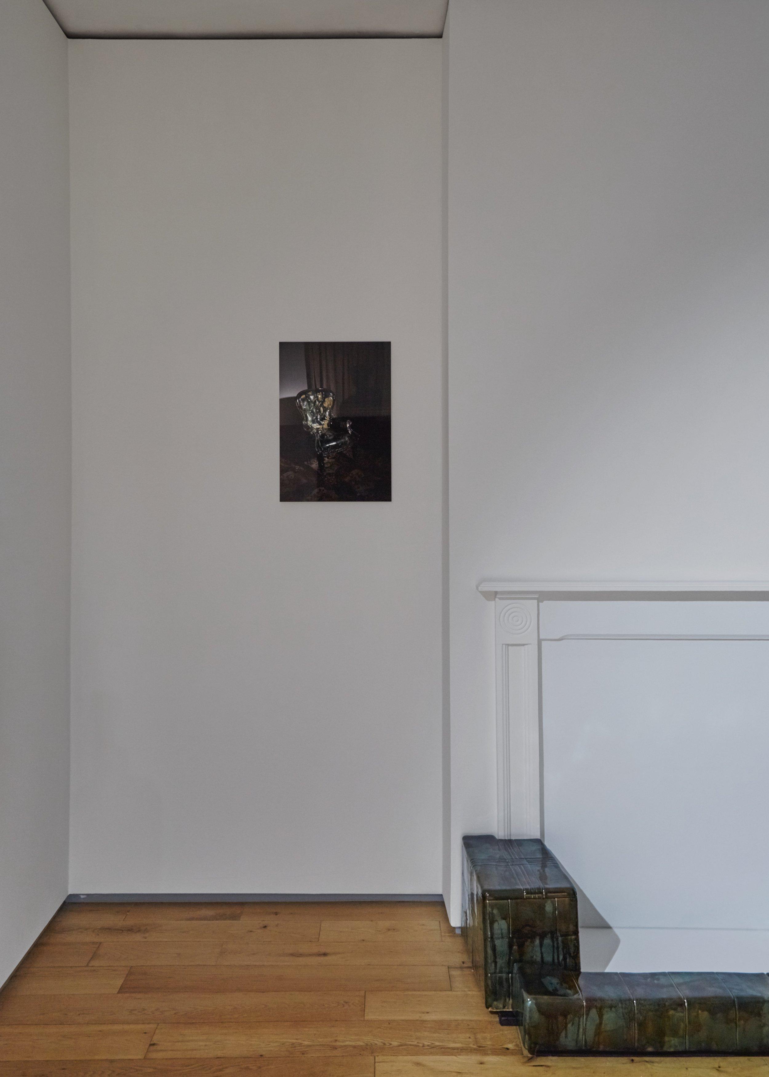 Visitor,  2019 Fujiflex print on aluminium dibond 36 x 50 cm   Strange Comfort (fire surround),  2019 Stoneware ceramic and glaze 28 x 135 x 52 cm