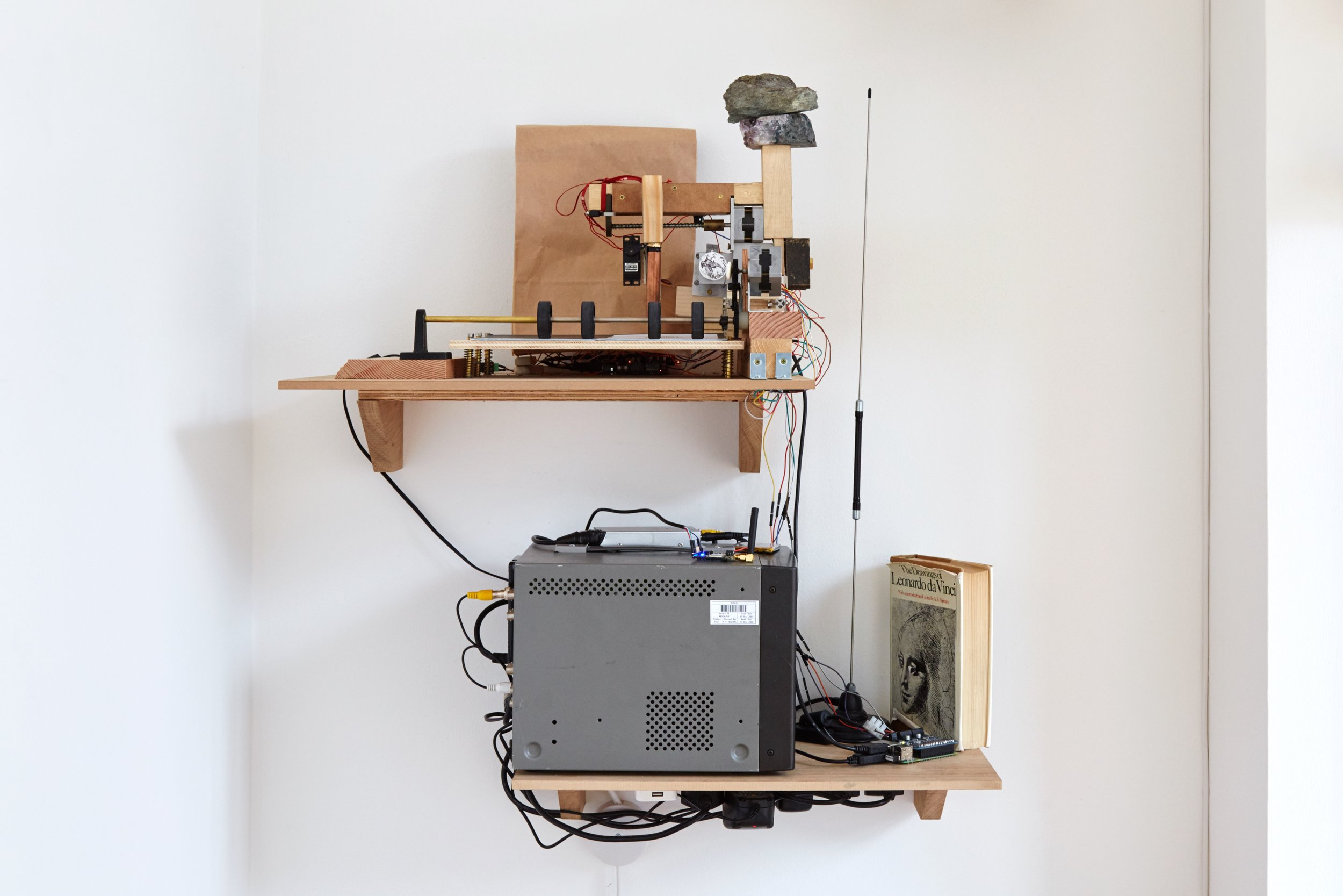 Congratulations  恭喜你 ,  2019 Cherry, Douglas Fir, Plywood, Oak Veneered MDF and MDF, with Motors, Ribbon, CRT Monitor,  The Drawings of Leonardo Da Vinci  (Hardback), Radio Aerial, Arduino's, Raspberry Pi, Signal Receiver, Sim Card, Various Fixings, Bronze, Rock and Amethyst, Pen on Paper, Gel Pens, Copper and Aluminium Parts, Greetings Cards,  Love Hearts  Sweet, Various Fixings, Clamp, Elastic Band, Plastic Wheels, Cast Metal and Electronic Components 90 x 75 x 42 cm